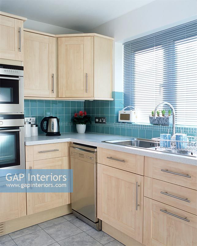 GAP Interiors - Modern kitchen with integrated appliances and light ...