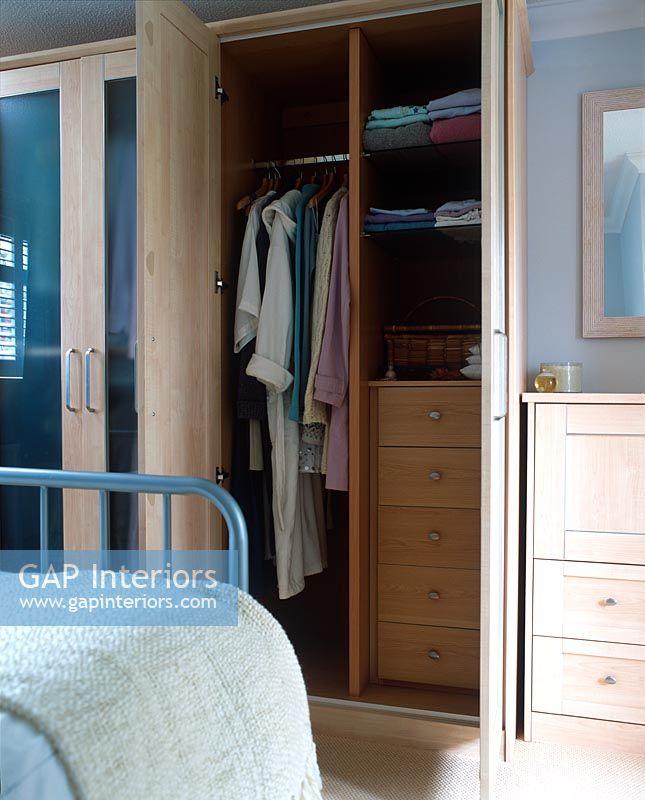 Open Bedroom Storage: Bedroom With Wardrobes Open Showing
