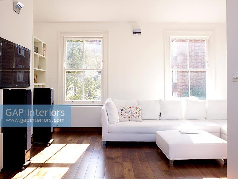 surprising white living rooms dark wood floors | GAP Interiors - Modern white living room with dark wood ...
