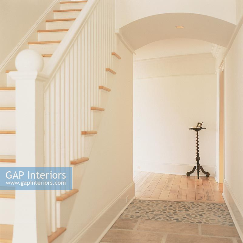 Staircase and hallway with different flooring