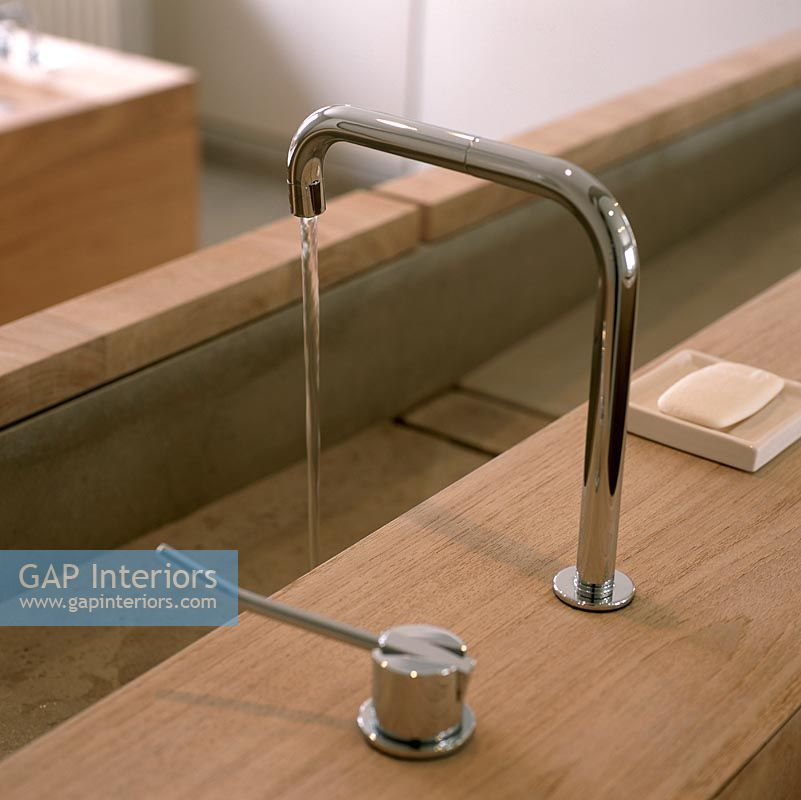Closeup of chrome sink tap in bathroom