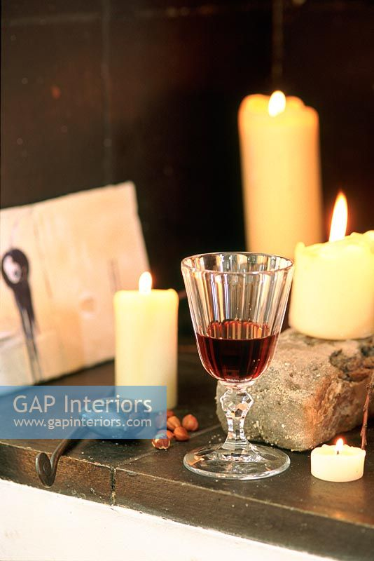 Burning candles and wine glass