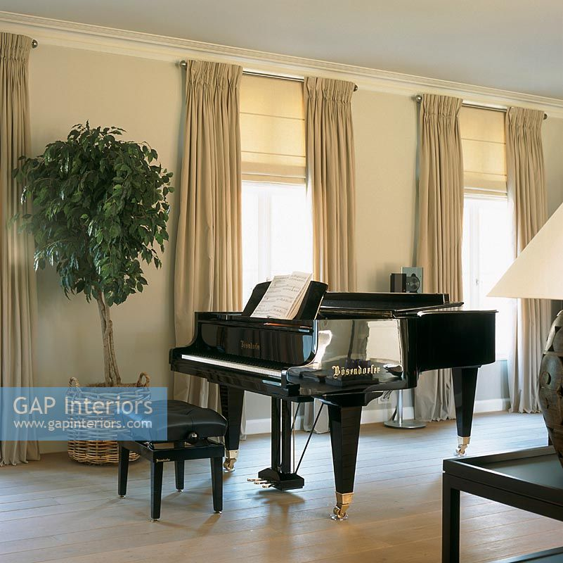 Grand piano with music in room
