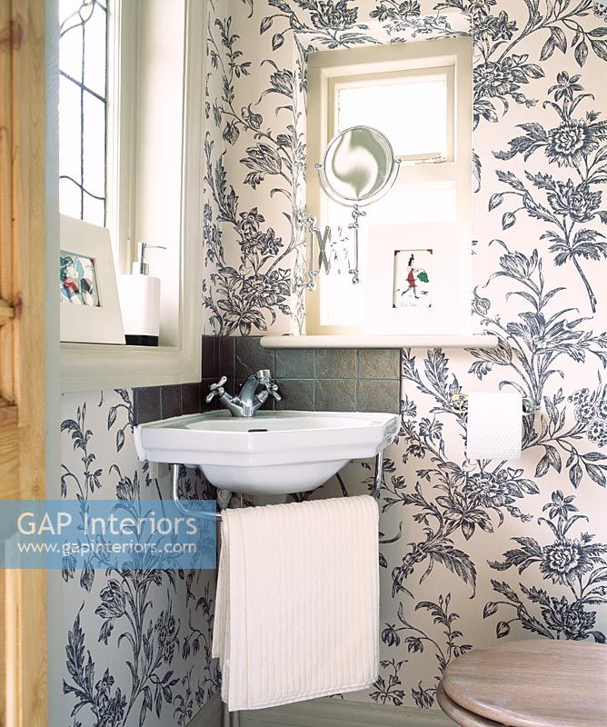 Bathroom With Floral Wallpaper And Sink