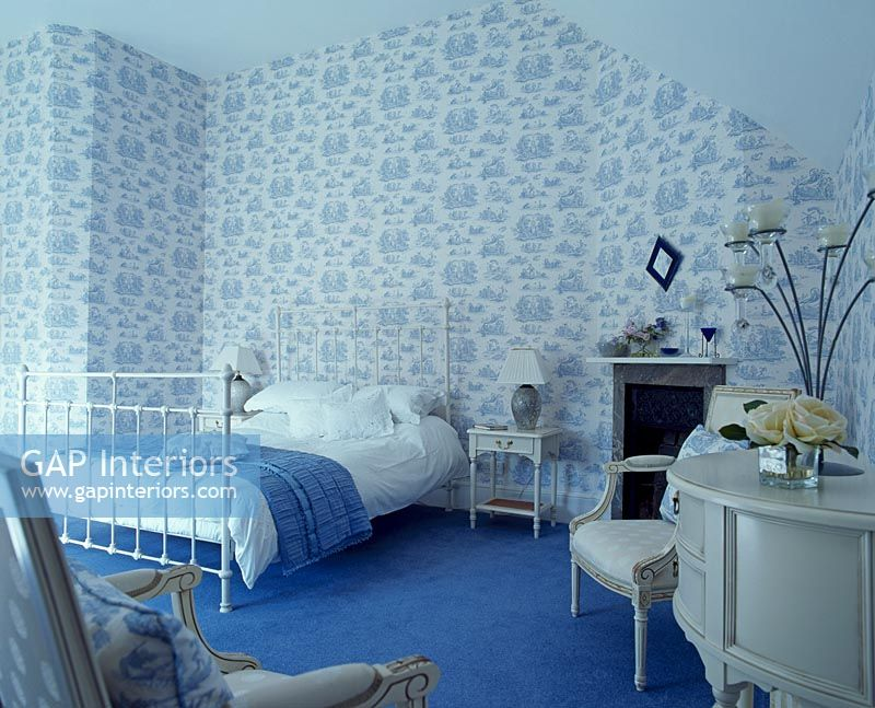 Bedroom with patterned wallpaper and blue carpet. GAP Interiors   Bedroom with patterned wallpaper and blue carpet
