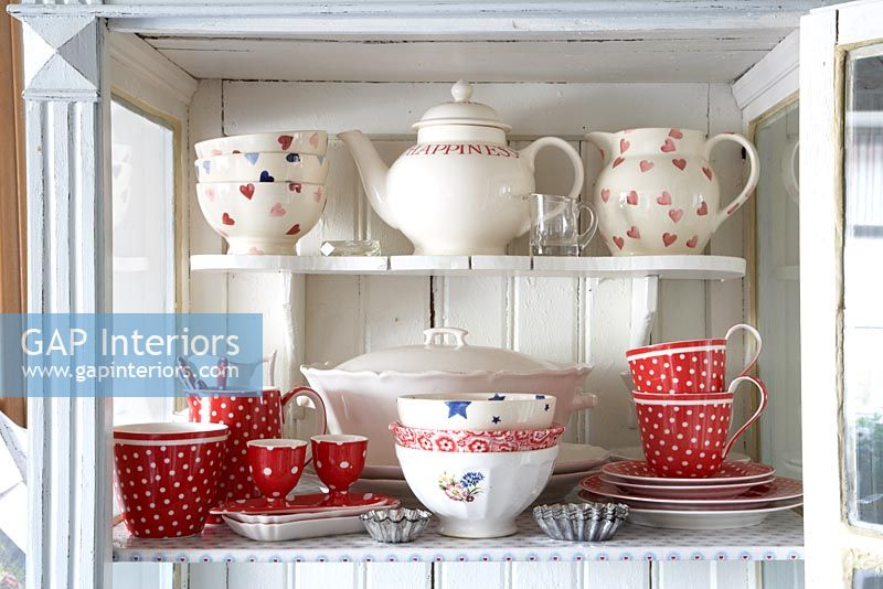 Collection of crockery in cabinet