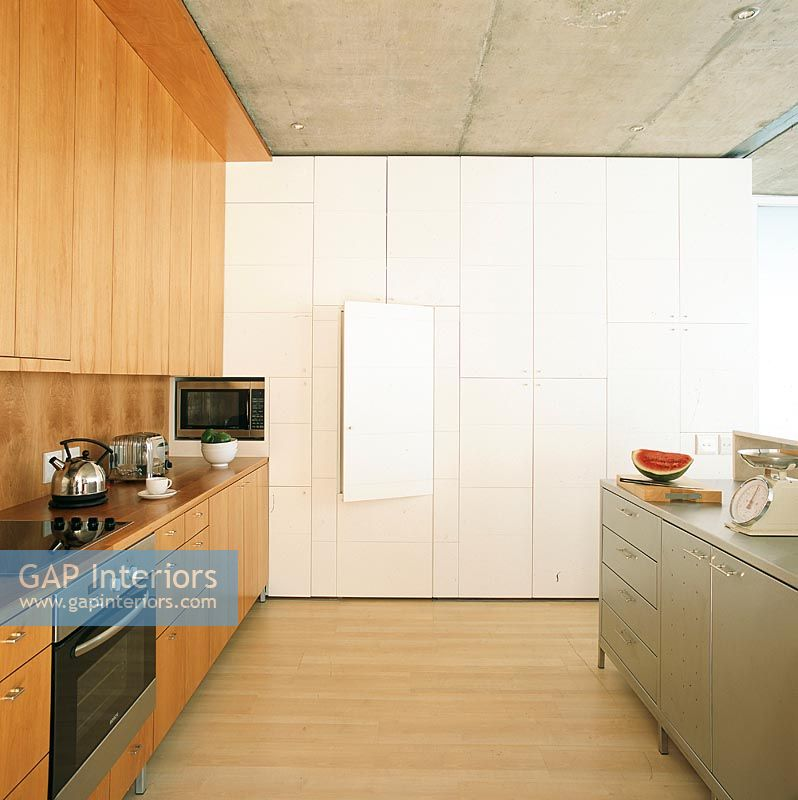 Kitchen Cabinets Zimbabwe: Modern Kitchen With A Wall Of Hidden