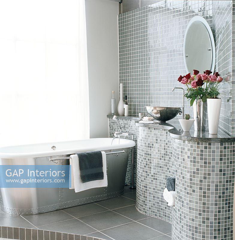 modern bathroom with silver and grey colour scheme