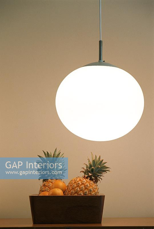 Bowl of fruit and hanging lamp