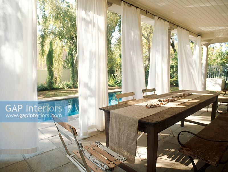 Gap Interiors Poolside Veranda With Hanging White Curtains Image No 0037973 Photo By