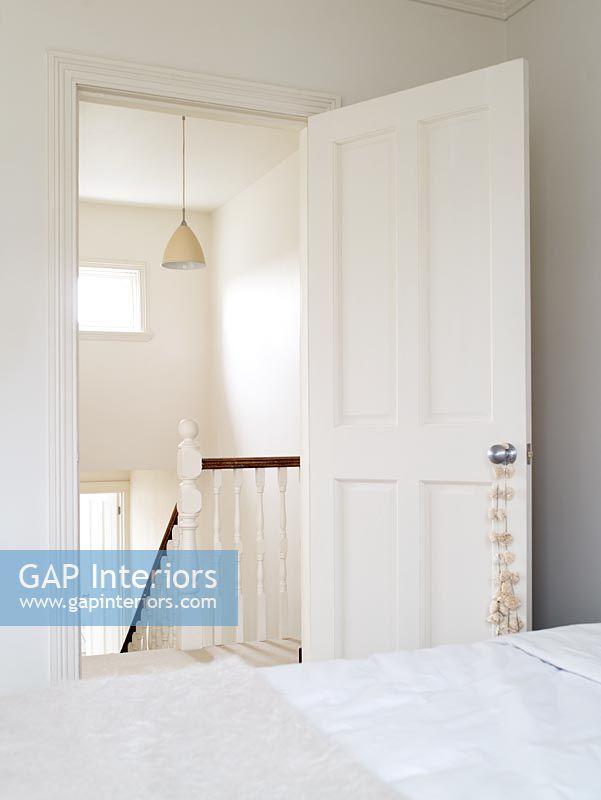 Bedroom door open to white hallway. GAP Interiors   Bedroom door open to white hallway   Image No