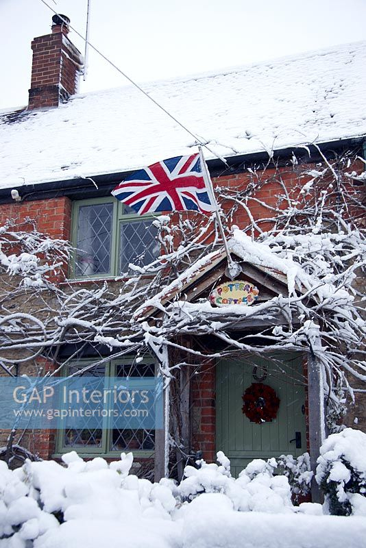 Country cottage exterior in the snow