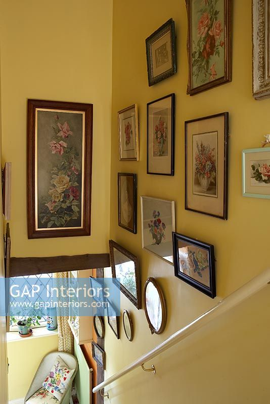 Country staircase with framed paintings