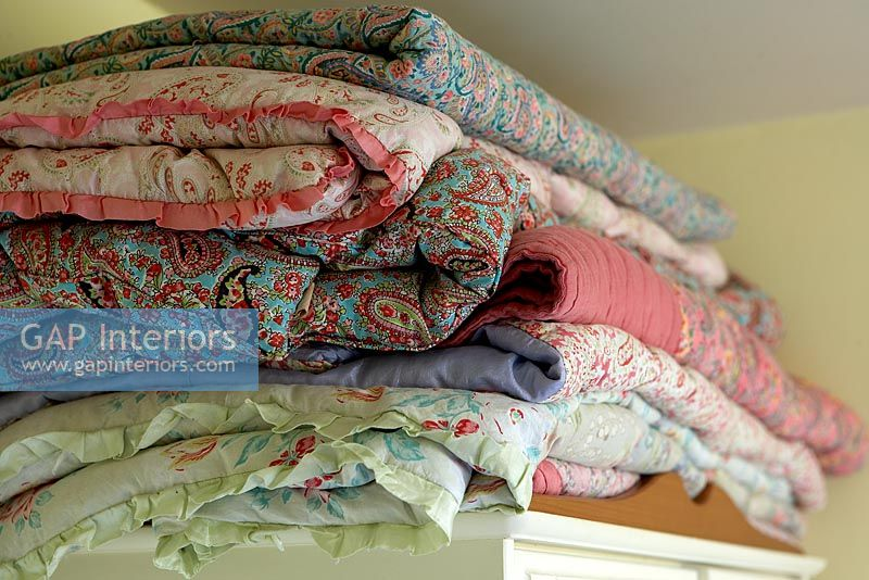 Stack of floral eiderdowns