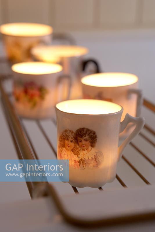 Candles in classic tea cups