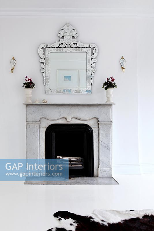 Marble fireplace in modern white living room