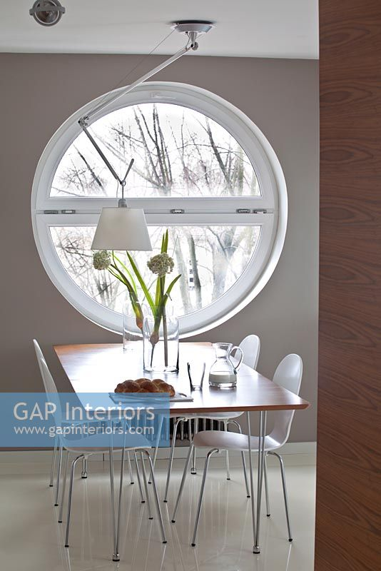 Gap interiors modern dining room with round window for Dining room no windows