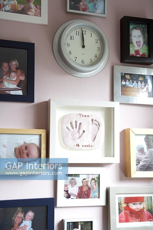 Wall of family photographs and collectibles