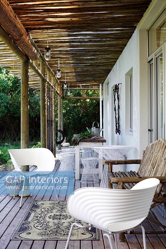 GAP Interiors Modern furniture on country house veranda Image