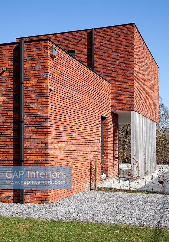Gap Interiors Modern Red Brick House Exterior Image No