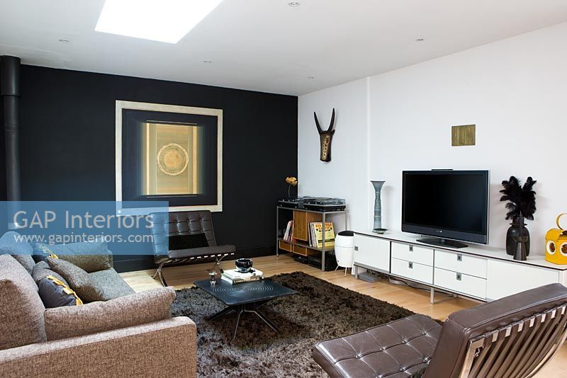 Contemporary Living Room With Leather Armchairs And Black Feature Wall Part 22