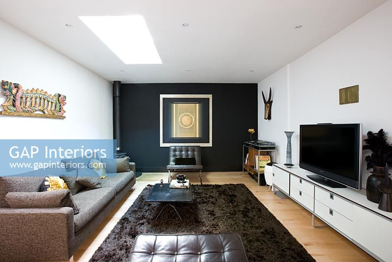 Contemporary Living Room With Black Feature Wall And Brown Rug Part 5