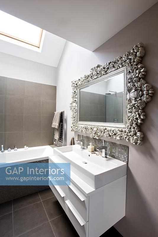 Wonderful Sink Unit And Ornate Mirror In Bathroom