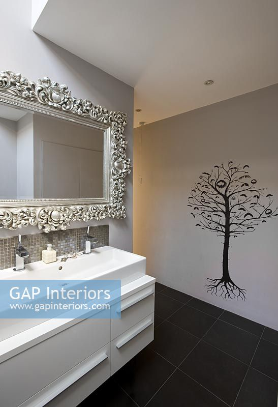 Sink Unit, Ornate Mirror And Tree Wall Mural In Bathroom