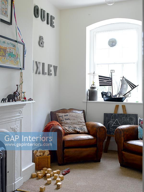 GAP Interiors - Childs room with leather armchairs - Image ...