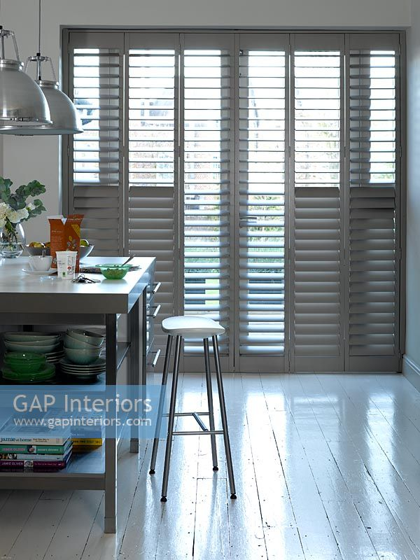 Full length shutters in kitchen