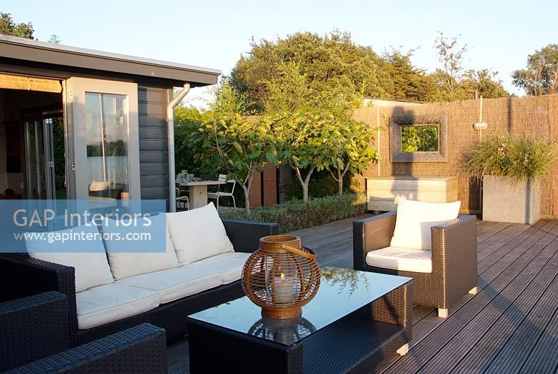 Contemporary garden with sofas