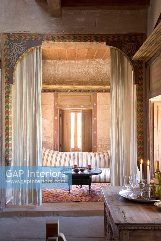 Ornate Doorway With Curtains Between Rooms