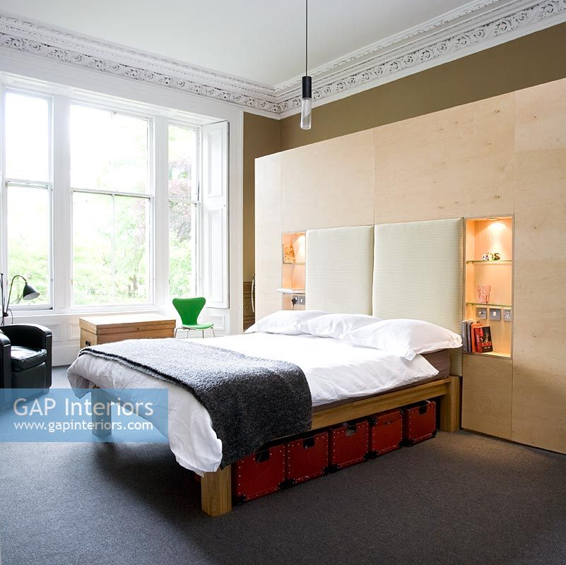 Modern bedroom with wooden feature wall