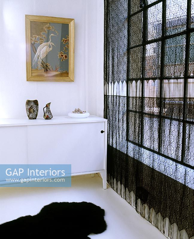 Black Lace Curtains And White Sideboard