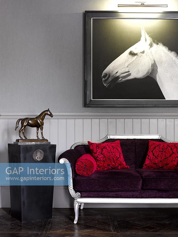 Horse artwork next to sofa