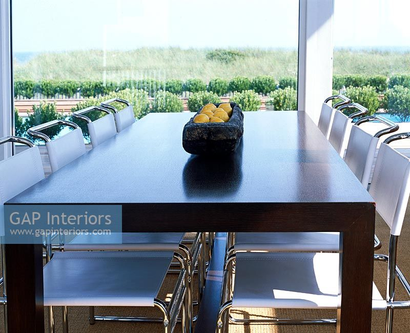GAP Interiors Contemporary dining table next to large  : 0054958 from gapinteriors.com size 800 x 650 jpeg 97kB