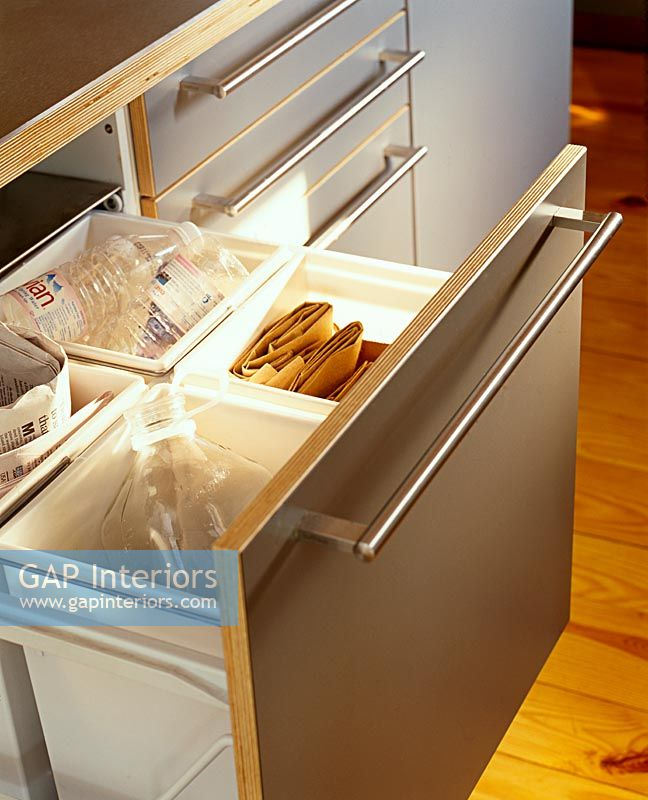 Recycling drawer in modern kitchen
