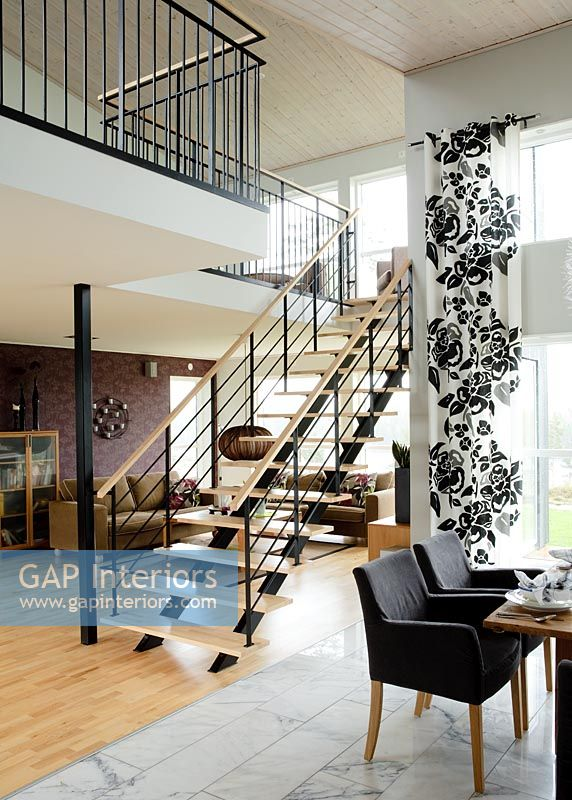 Central staircase in modern open plan area