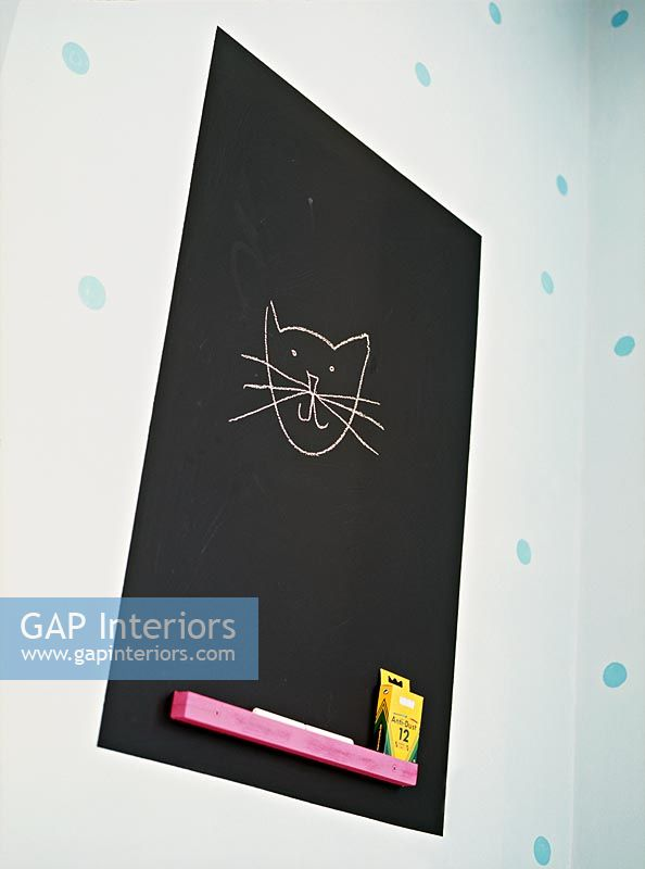 Cat drawn on blackboard in childrens room