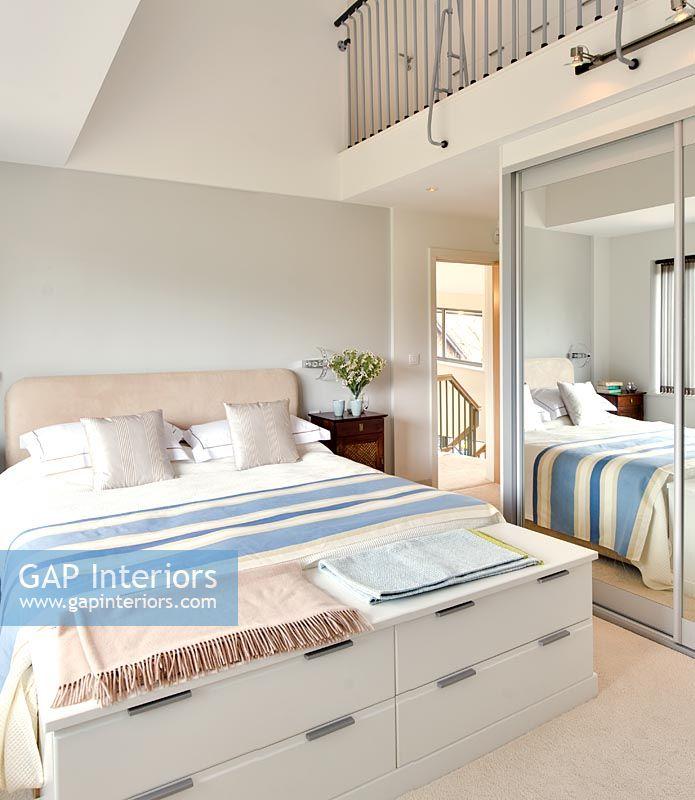 GAP Interiors - Modern bedroom with mezzanine floor above - Image ...