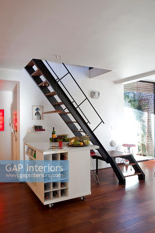 Staircase from contemporary kitchen