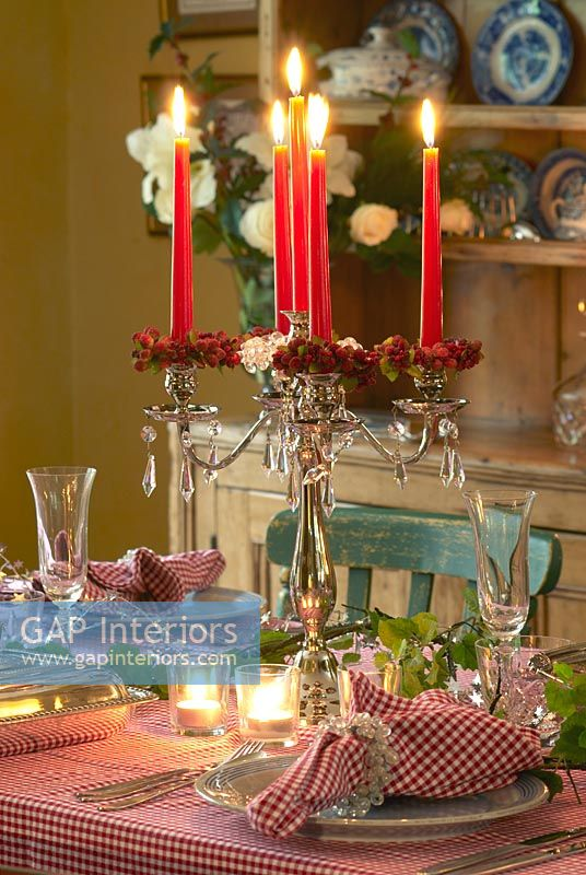 GAP Interiors - Decorative candelabra on Christmas dining table ...