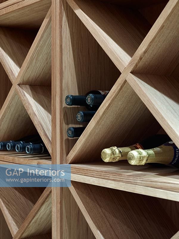Detail of wine in wooden rack