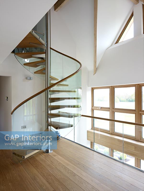 Contemporary hallway and spiral staircase