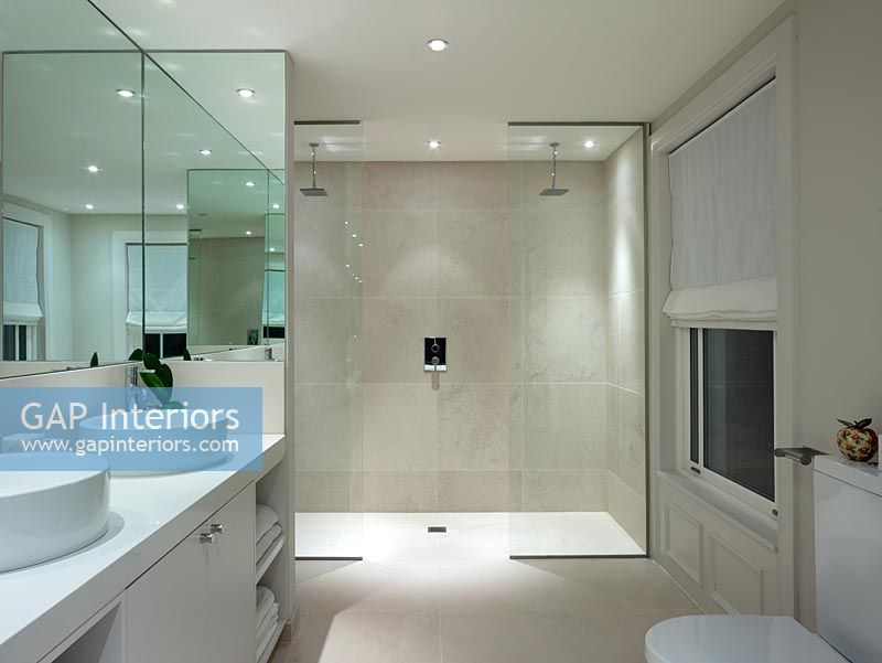 gap interiors modern bathroom with double shower image