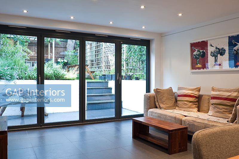 Large patio doors in modern living room - GAP Interiors - Large Patio Doors In Modern Living Room - Image No