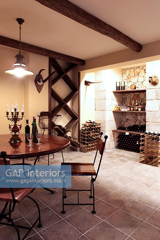 Classic wine cellar with table and chairs