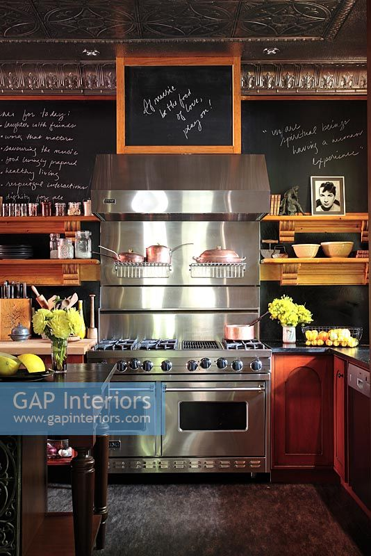 Large stainless steel range cooker in kitchen