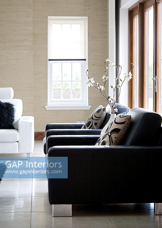Contemporary black leather armchairs