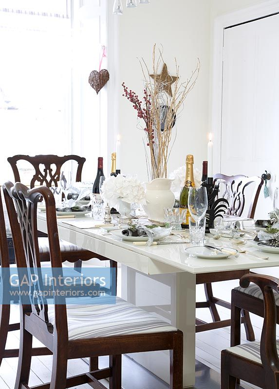 Modern dining room decorated for Christmas meal